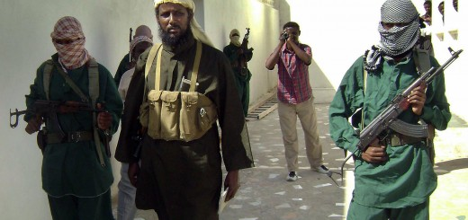 The spokesperson for Somalia's Al-Shabaab militant group, Robow Abu Mansur (C), is escorted on December 14, 2008 by bodyguards to a press conference just outside Mogadishu. Mansur announced a continuation of hostilities toward the Ethiopian-backed Somali interim government as President Abdullahi Yusuf sacked his prime minister and entire cabinet on December 15 for failing to secure peace in the troubled horn of Africa nation before naming close ally Mohamoud Mohamed Gouled. AFP PHOTO/ Mokhtar MOHAMED (Photo credit should read MOHAMED MOKHTAR/AFP/Getty Images)
