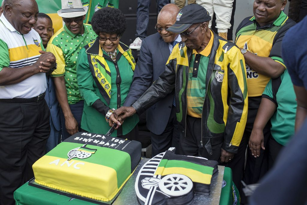 SOWETO, SOUTH AFRICA - JANUARY 06 :   South African President Jacob Zuma (R) and Winnie Mandela (L) attend a celebration ceremony ahead of the 105th Anniversary of African National Congress (ANC) in Soweto, South Africa on January 06, 2016. The African National Congress will hold the celebrations for the 105th Anniversary on January 08.  (Photo by Ihsaan Haffejee/Anadolu Agency/Getty Images)