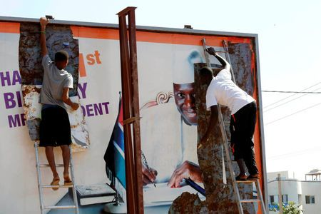 People tear a poster of former Gambian president Yaya Jammeh in Broussbi