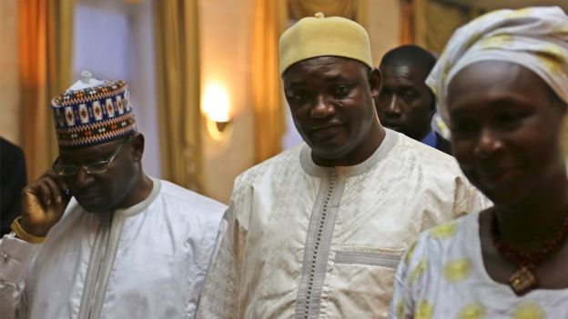 Adama Barrow, centre, says he intends to investigate allegations of human rights abuses during Mr Jammeh's time in office
