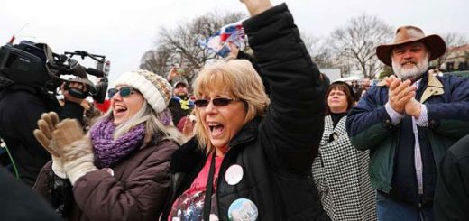 US President Donald Trump supporters react on the National Mall to the inauguration of Donald Trump on January 20, 2017 in Washington, DC.